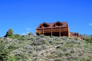 Hillside log home