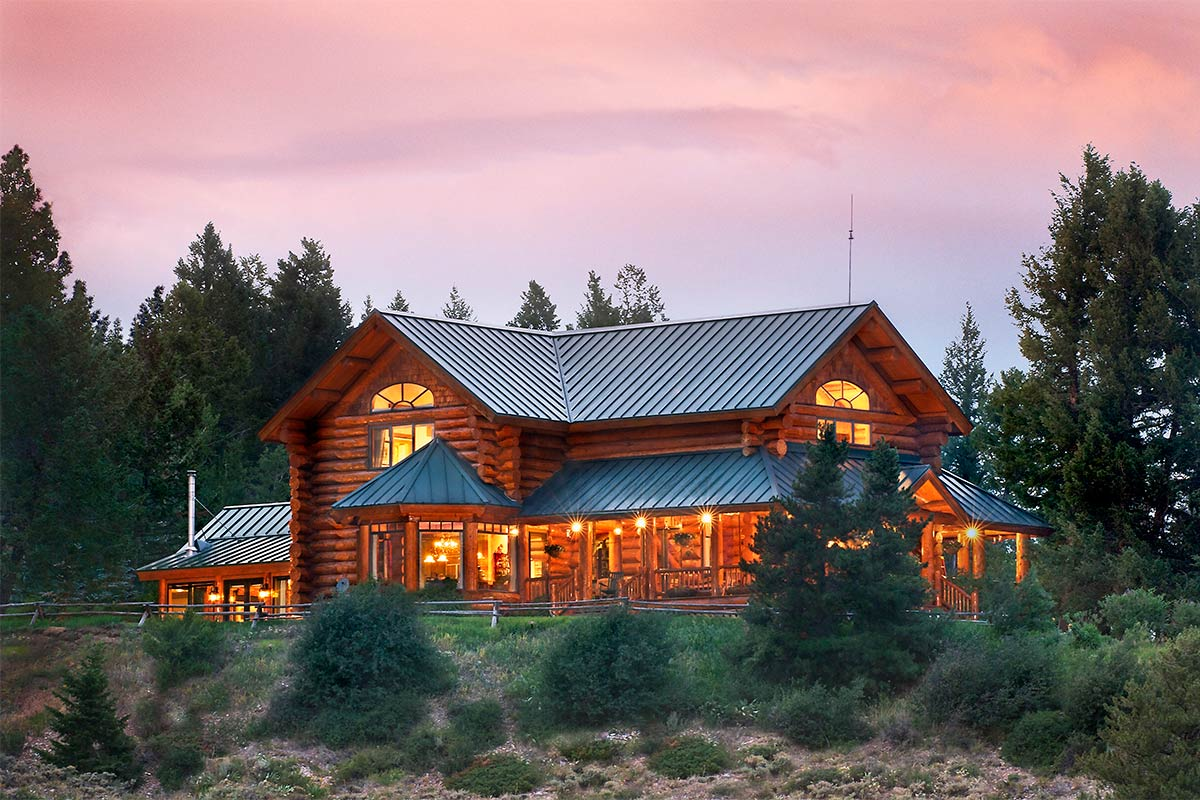 Shadow-Creek-Ranch-Stunning-Mountain-Log-Home-on-Recreational-Ranch-for-Sale-01-Dusk-Amazing-Sunset